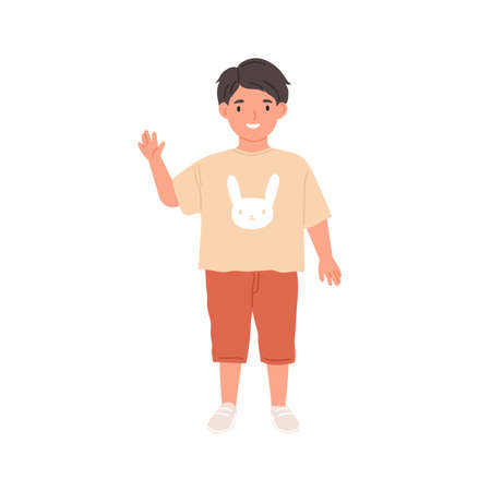 Happy kid waving with hand and saying hello. Hi gesture of smiling child. Portrait of schoolboy or preschooler in t-shirt, shorts and trainers. Flat vector illustration isolated on white background Ilustrace
