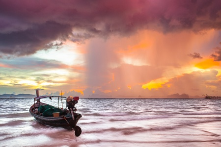 yellow boats: Fishing boat before the storm