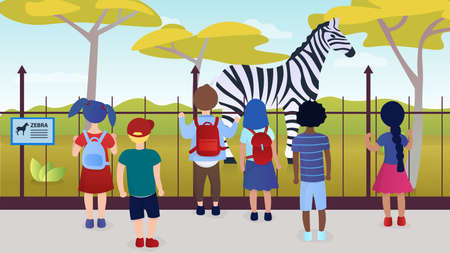 Group of kids watching giraffe at a zoo excursion. School or kindergarten students on filed trip.