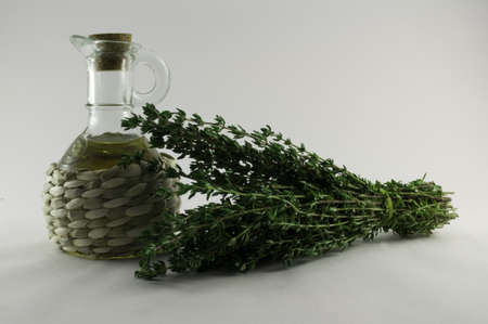 lubricator: Fresh and useful thyme with a bottle of oil