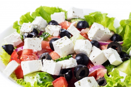 greek salad in plate closeup isolated on white background photo