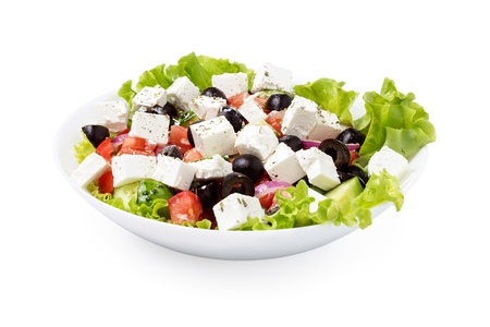 greek salad in plate isolated on white background photo