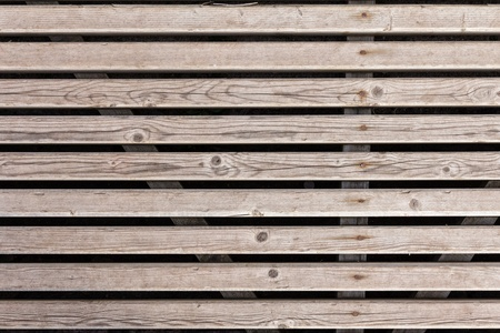 background from horizontal planks with rusty nails photo