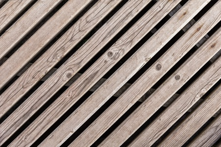 background from diagonal planks with rusty nails photo