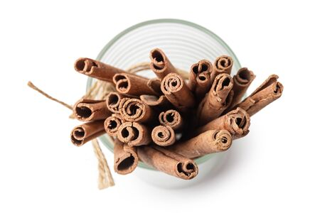 tied sticks of cinnamon in the glass isolated on white