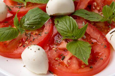 fresh caprese salad on plate closeup shot photo