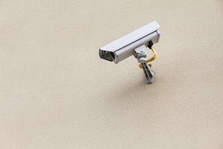 mounter: white security camera mounter on wall Stock Photo