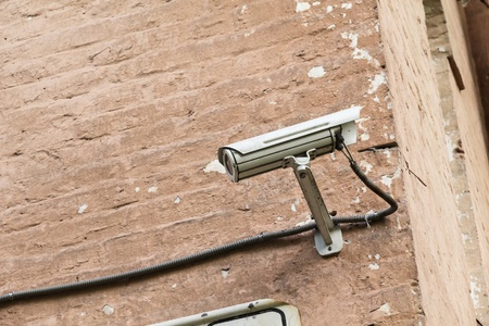 white security camera mounter on wall Stock Photo - 16022160