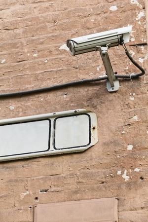 white security camera mounter on wall Stock Photo - 16022144