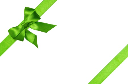 Green ribbons with bow with tails isolated on white background photo