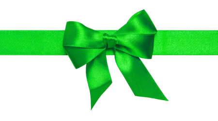 Green ribbon with bow with tails isolated on white background Stock Photo - 16145568