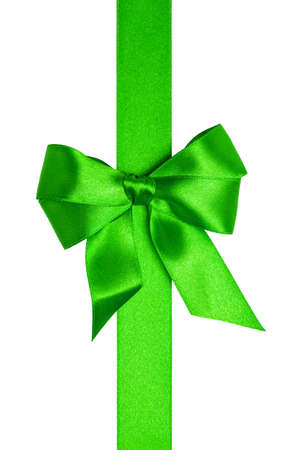 Green ribbon with bow with tails isolated on white background Stock Photo - 16145580