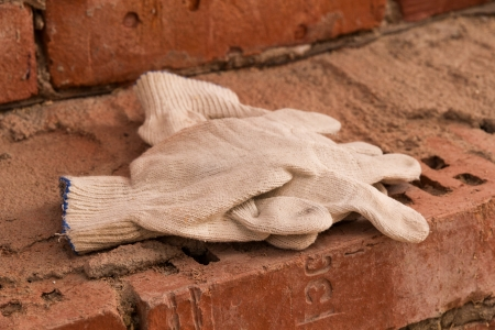 white cloth protective  gloves on red bricks Stock Photo - 16145574