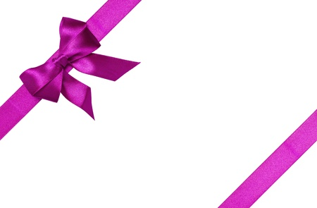 Purple ribbons with bow with tails isolated on white background Stock Photo - 16145556