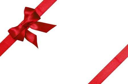 Red ribbons with bow with tails isolated on white background Stock Photo - 16145554