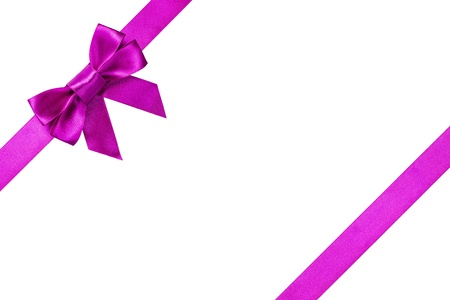 Purple ribbons with bow with tails isolated on white background photo