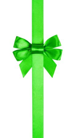 green ribbon with bow with tails isolated on white background photo