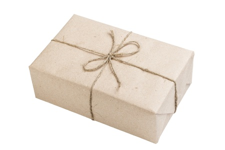 blank parcel with bow isolated on white photo
