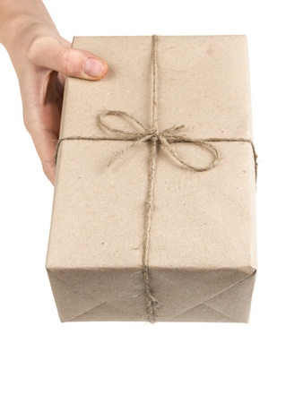 hand with a parcel isolated on white background photo