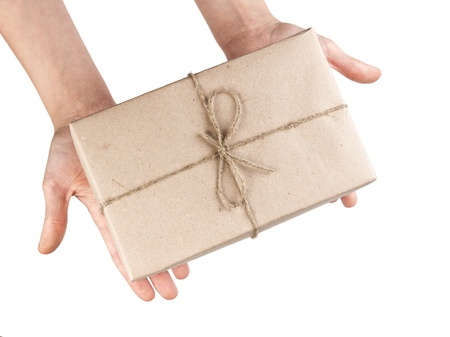 hands with a parcel isolated on white background photo