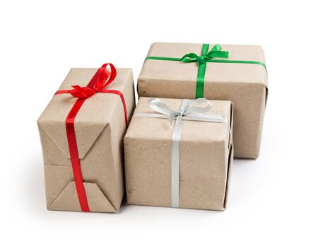 three gift boxes from recycled paper isolated on white photo