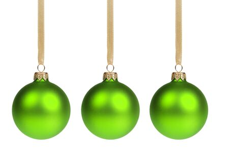 three christmas balls hanging on ribbon isolated on white photo