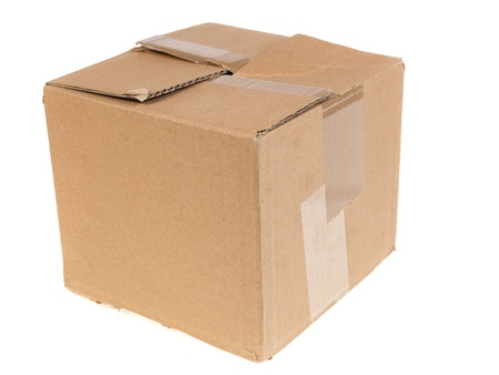 battered cartboard box isolated on white background photo