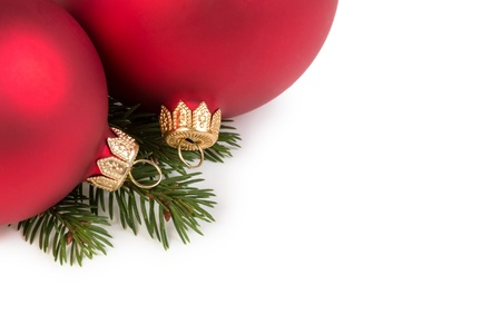 christmas decorations with white background: christmas balls on fir branch, white background