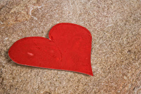 paper heart on stone, valentine's background photo