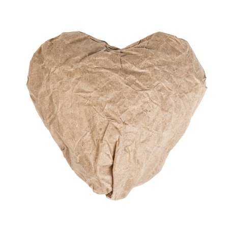 heart from crumpled paper isolated on white photo