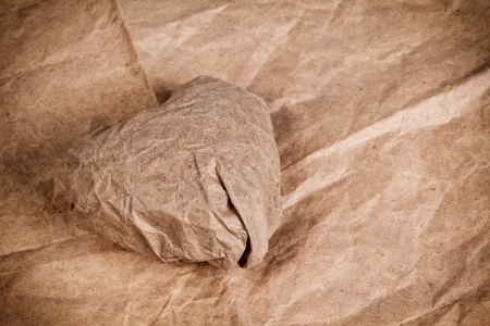 paper heart on crumpled paper, valentines background photo
