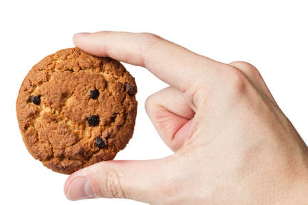 cookie with chocolate pieces in hand, isolated Stock Photo - 16868271