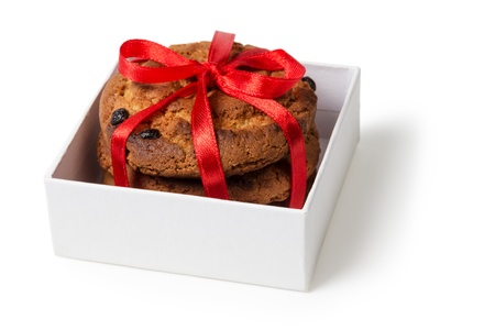 cookies with chocolate pieces in box isolated photo