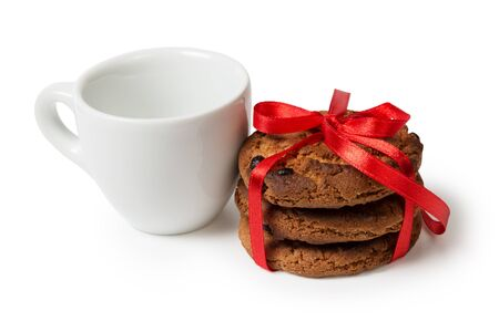 cookies with chocolate pieces and cup, isolated photo