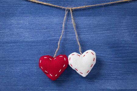 two textile hearts over wooden wall, can be used as a background Stock Photo - 16971005