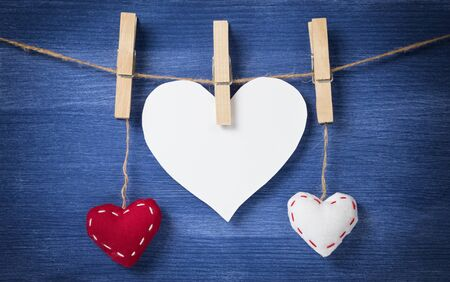 blank white heart with two textile, valentines background photo