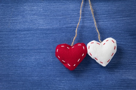 two fabric hearts on wooden background, valentines day theme Stock Photo - 17030348