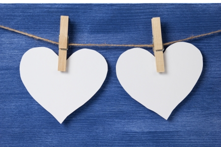 Two paper hearts hanging on a rope, valentines day theme Stock Photo - 17030341