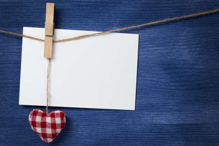 fabric heart and empty card on wooden background, valentines day theme photo