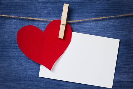 paper heart and card hanging on a rope, valentines day theme Stock Photo - 17038819