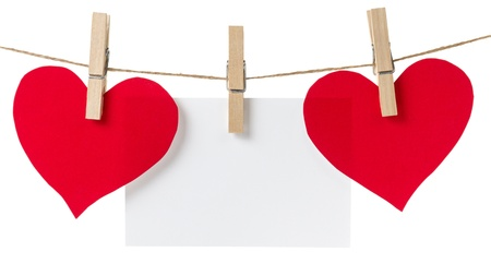 two red paper hearts and card hanging, isolated on white photo