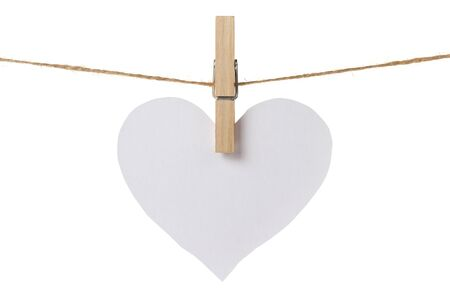 white paper heart hanging, isolated on white photo