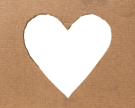 hole in a shape of heart on cardboard, valentines theme photo