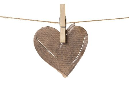 damaged cardboard heart hanging, isolated on white Stock Photo - 17030365