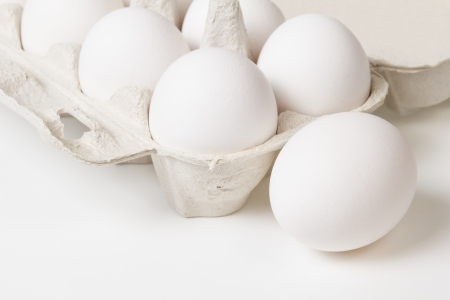 detail photo of open container with eggs, space for text photo
