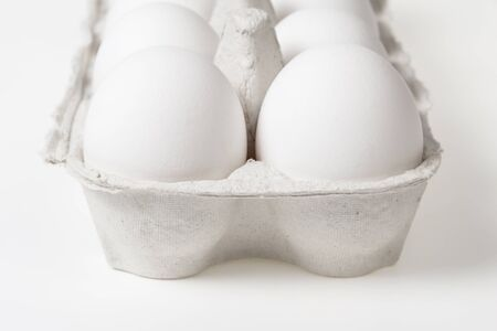 detail photo of open container with eggs, can be used as a background photo
