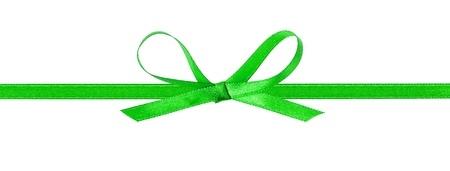 thin green bow with horizontal ribbon, isolated on white photo