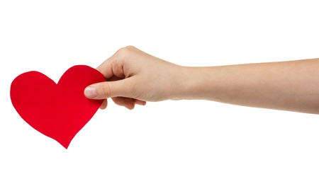 female teen hand holding paper heart, isolated on white Stock Photo - 17377118