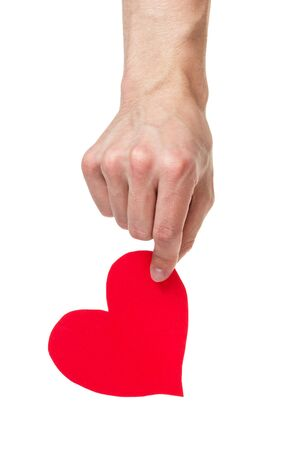 adult male hand holding paper heart, isolated on white Stock Photo - 17377117