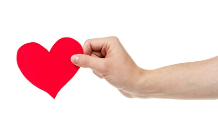 adult male hand holding paper heart, isolated on white photo